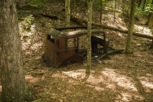 An abandoned car on trail